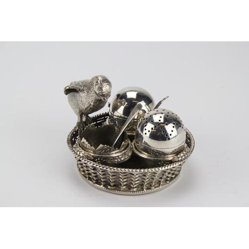 47 - Mappin & Webb Antique Chick Cruet Set consisting of 3 eggs, 2 spoons & Base Basket.