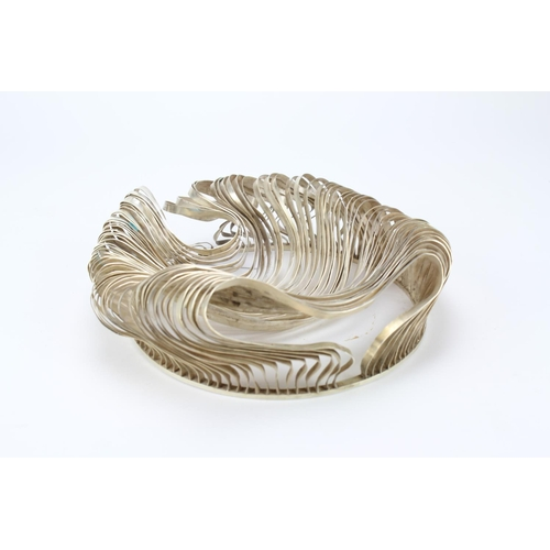 9 - A Sidsel-Dorph Jensen Silver Bowl of flowing Ribbon & Curved Form resting on a circular pierced base...