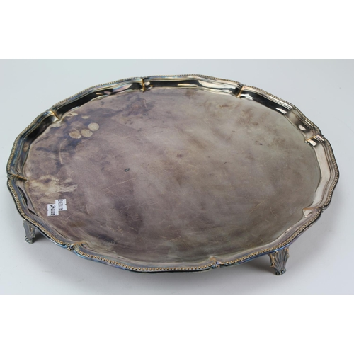 48 - A Sheffield Plated Bead edged Salver resting on Pad Feet. 40cms across....