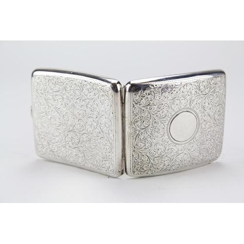 41 - A Large Victorian silver engraved cigarette case....