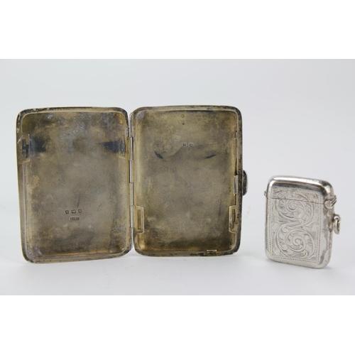 30 - A Victorian silver engraved Cigarette case and a silver vesta case....