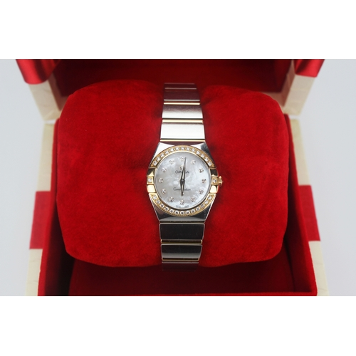 63A - A Ladies Omega Constellation Watch with a 12 Diamond Mother of Pearl Dial, a Gold 28 Diamond Bezel, ...