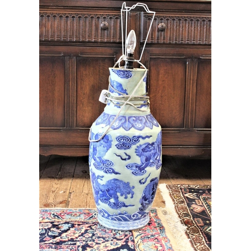 327 - A Chinese blue and white vase, decorated with stylised shi shi....