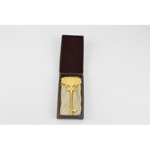 138 - A gilt bronze key, presented to the reverent C Lesley Craig, for the reopening of the Stephan Hill M...