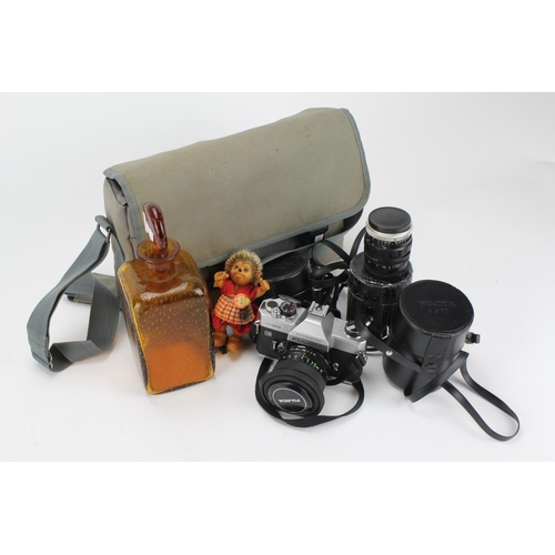 121 - A collection of camera equipment, lenses, along with a Steiff hedgehog, and a decanter....