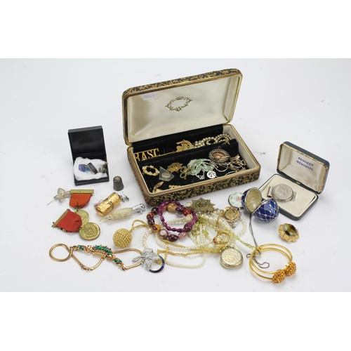 42 - A collection of costume jewellery, including a silver and enamelled necklace, collectors egg in blue...