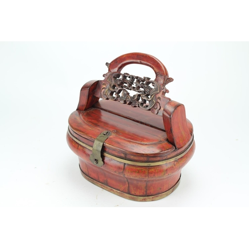 344 - A Chinese swing handled food box, with detachable lid, and brass fitments....