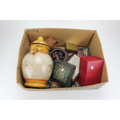112 - A box containing leather paper weights, tins and other collectables....