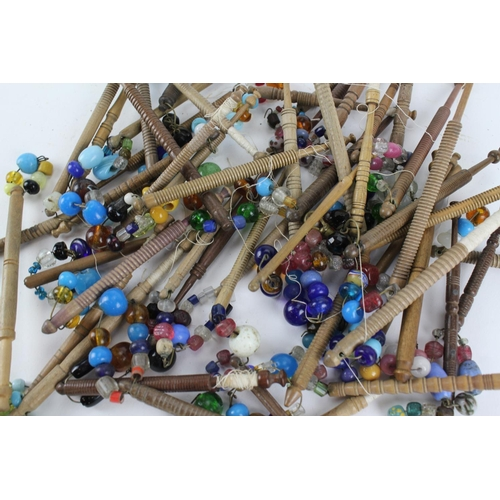 408 - A large collection of 18th & 19th century bead work & other lace bobbins....