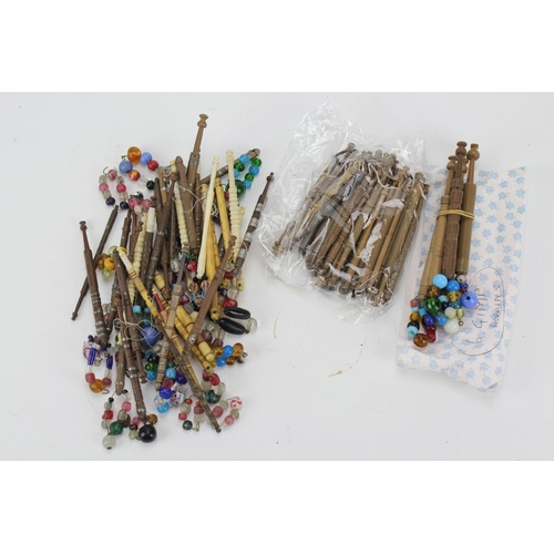 409 - A collection of 18th & 19th century bead work & other lace bobbins....