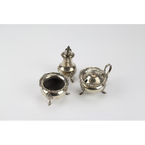 7 - A Georgian design 3 piece Cruet Set resting on Pad Feet. Birmingham 1935. 6 Oz....