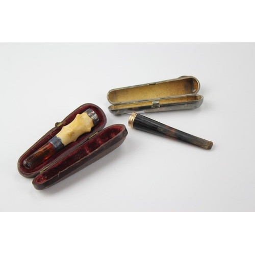 2 - A 9 carat gold cigarette holder in a silver case, with one other with silver mounts....
