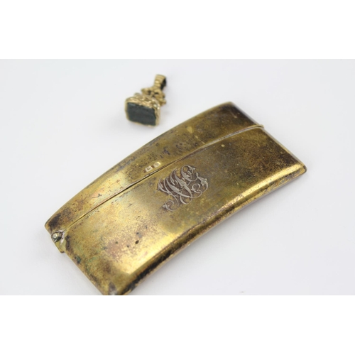 24 - A silver gilt card case with initials, and a fob....