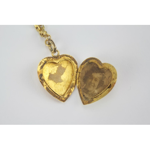 48 - A Chinese Gold Coloured Locket on a chain....