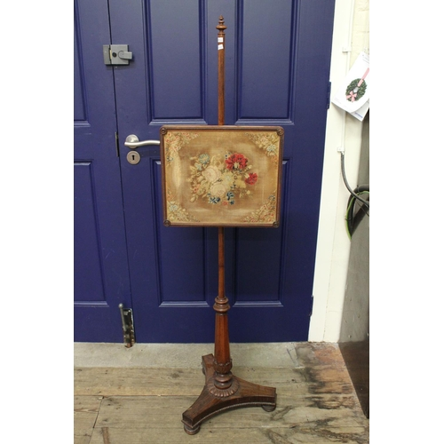 256 - A late 19th Century Rosewood pole screen decorated with a tapestry panel, resting on carved and shap...