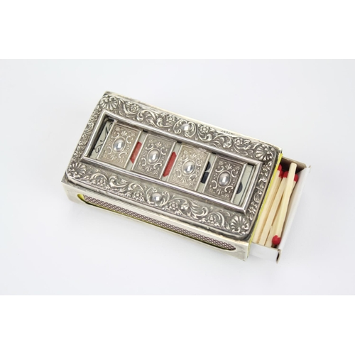 12 - A Rare Silver patented hallmarked match case holder, decorated with cards, no trumps, in a floral bo...