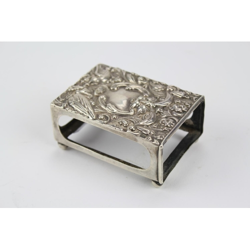 18 - A Silver match case, Birmingham C, decorated with masks and flowers....