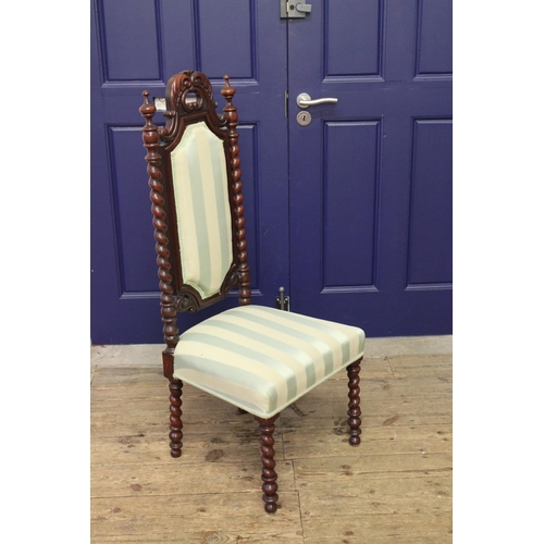 258 - A Victorian mahognay carved back chair, with barley twist supports....