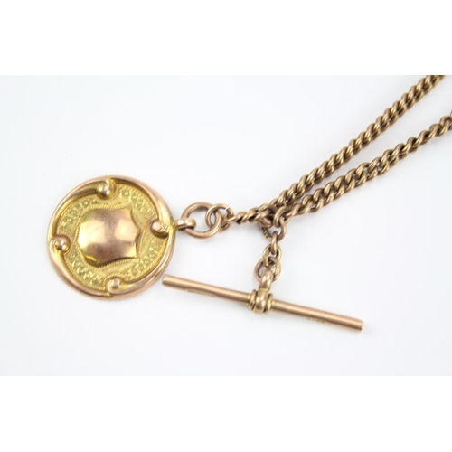 38 - A 9ct Rose Gold Albert chain with medallion. 27.2 grams....