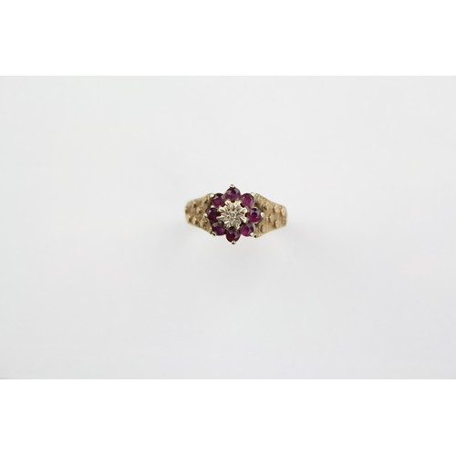 37 - A 9 carat Gold Ruby & Diamond Dress Ring with bark effect shoulder, Size S. 4.6 grams....