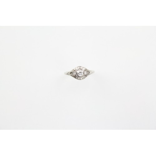 31 - A 1930's Diamond and platinum mounted Dress Ring with Diamond shoulders...
