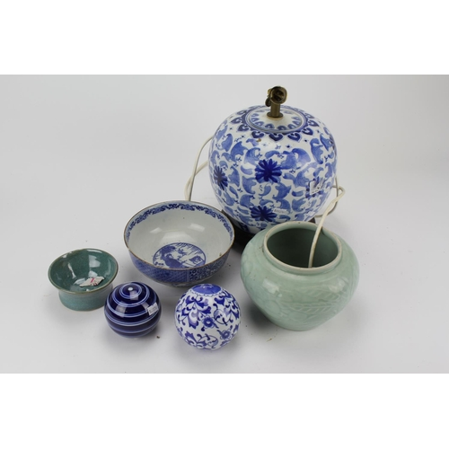 325 - A Chinese blue and white bulbous table lamp and stand, along with blue and white balls, and two bowl...