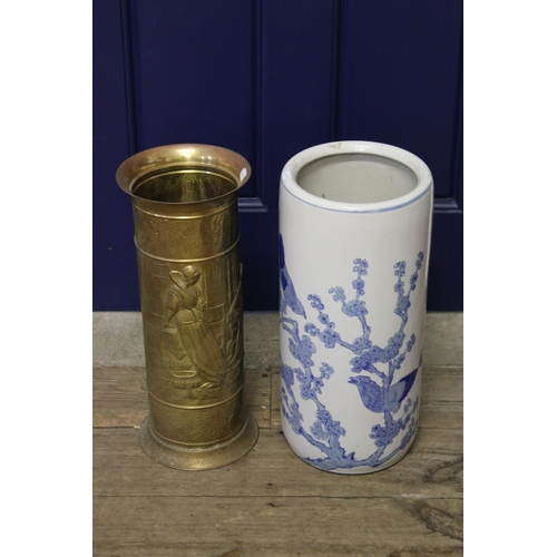 116 - A Chinese blue and white umberella stand, and one other in brass....