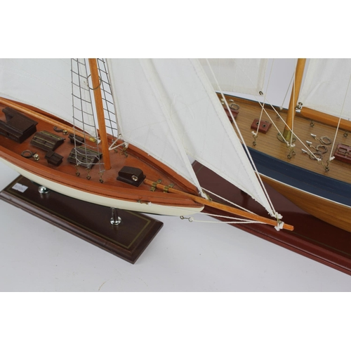 521 - A wooden built model of a three mast sailing yacht, and one smaller model....