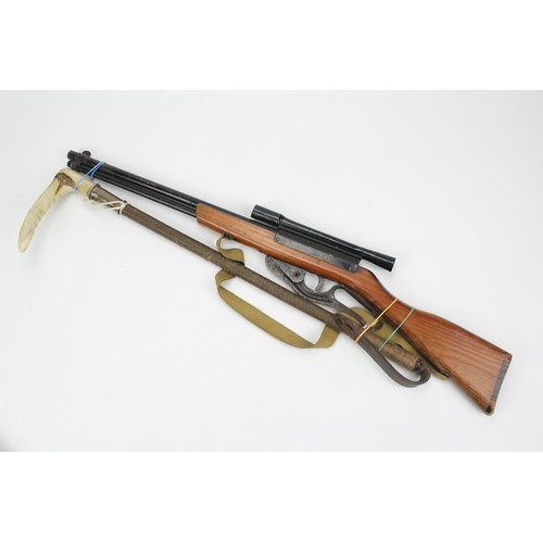 115 - A Child's Trainer Cadet Air Rifle with scope and a silver mounted riding crop....