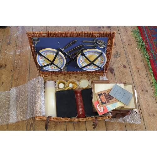 144 - A Late 19th Century Leather map case and a Wicker Picnic Set....