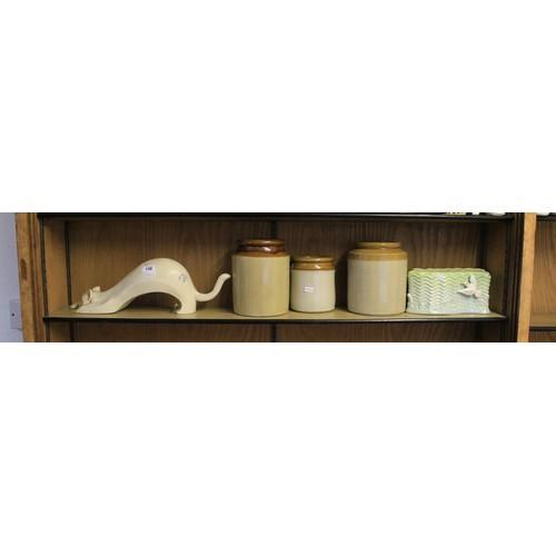 148 - A Metal study of a cat, storage jars, planters, etc....