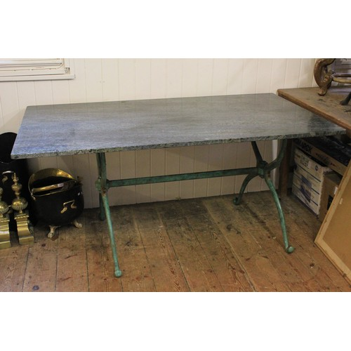 292C - A Green Marble table resting on a Green metal Base. 160cm Long x 90cm Wide....