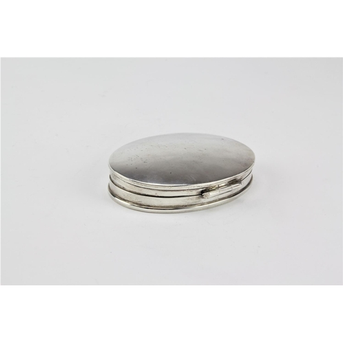 5 - A 925 Sterling Silver make-up box of oval form & planished interior....