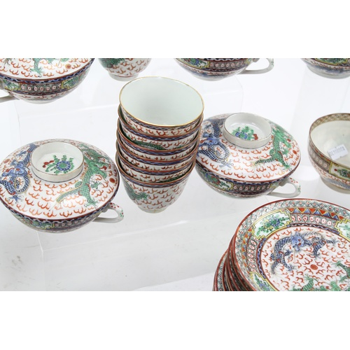 489 - 1920's Chinese export dinner set, decorated in blue and rust, dragon decorated, consiting of tea bow...