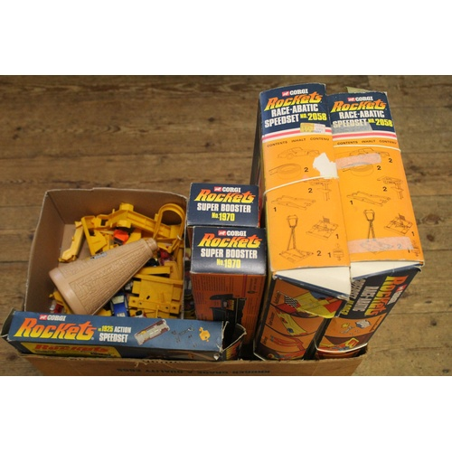 741 - A Large Collection of Corgi Rockets to include 2 x Boxed No: 1970 Super Boosters, 2 x No: 2058 Race-...
