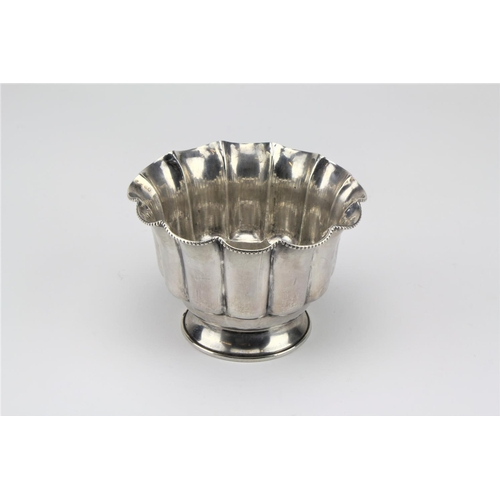 3 - A silver coloured white metal bowl with fluted decoration, marked 100 JM & R BOY IS....