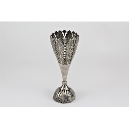 6 - A Chinese silver double handled vase, decorated with floral relief. 183 grams....