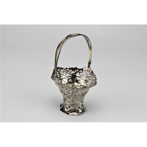 9 - A Dutch import sweet meat bowl, English silver marked, swing handled, Sheffield 1906. 161 grams....