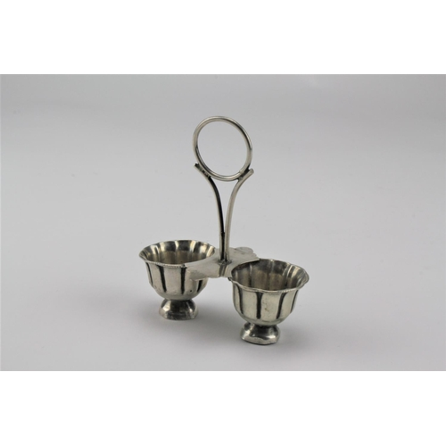 14 - An Indian Silver twin handled condiment pot with loop handle....