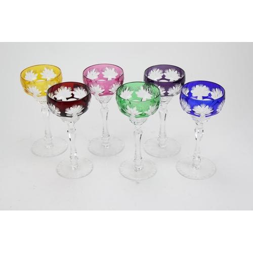 209 - A set of six cut glass Harlequin hock glasses....