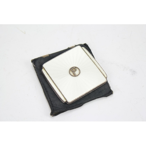 27 - A 1930's white enamelled powder compact shielded P....