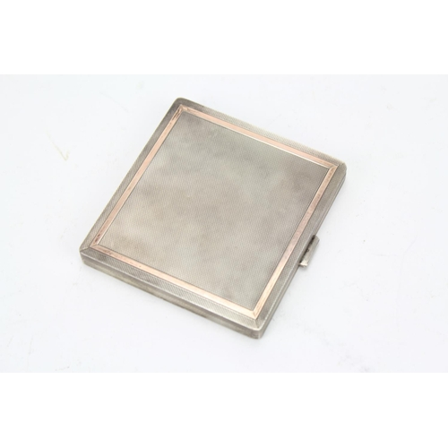 29 - A Ladies gold and silver engine turned cigarette case....