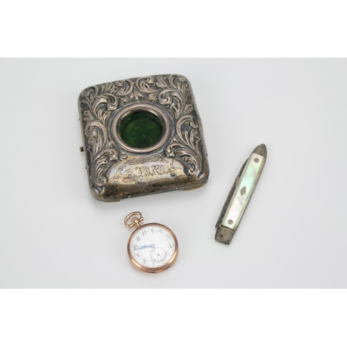 32 - A Victorian silver cased watch in a silver mounted  case and a pen knife....