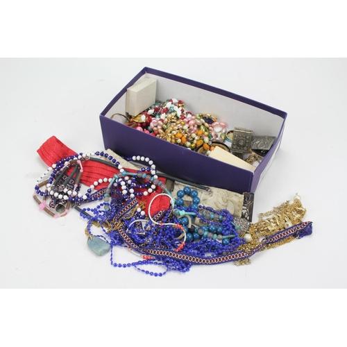 40 - A Victorian silver nurses buckle, native beads, costume jewellery, etc....