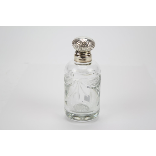 43 - A Silver mounted cut glass cologne bottle....