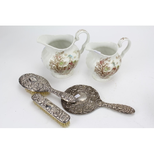 55 - A Silver Mirror, two brushes & two jugs....