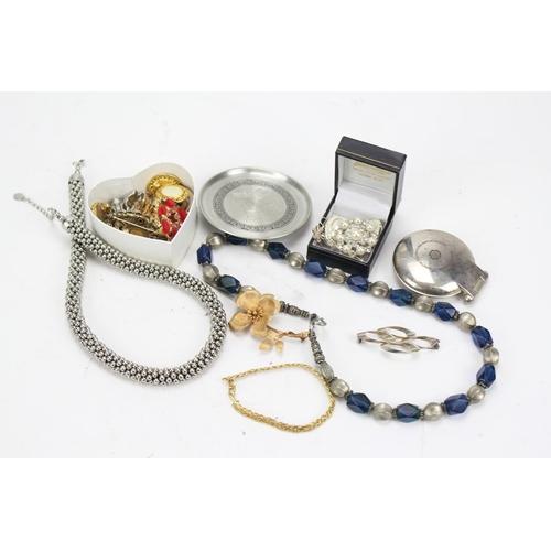 56 - A quantity of costume jewellery....