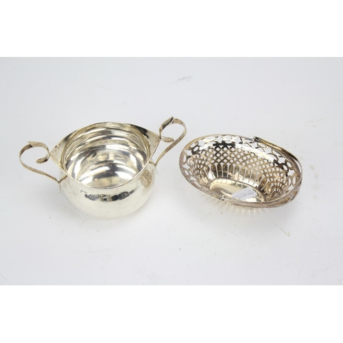 60 - A Silver twin handled sugar bowl and a small swing handled basket. Weight: 121.6g....