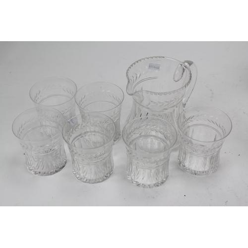 230 - A cut glass jug and a set of six Stuart tumblers....