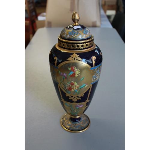 228 - A Royal Bonn design Art Nouveau blue gilt and floral decorated twin handled vase and cover....